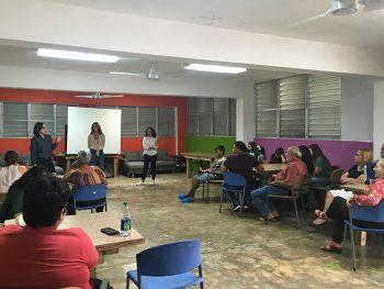 volunteers leading the community in a lighting workshop
