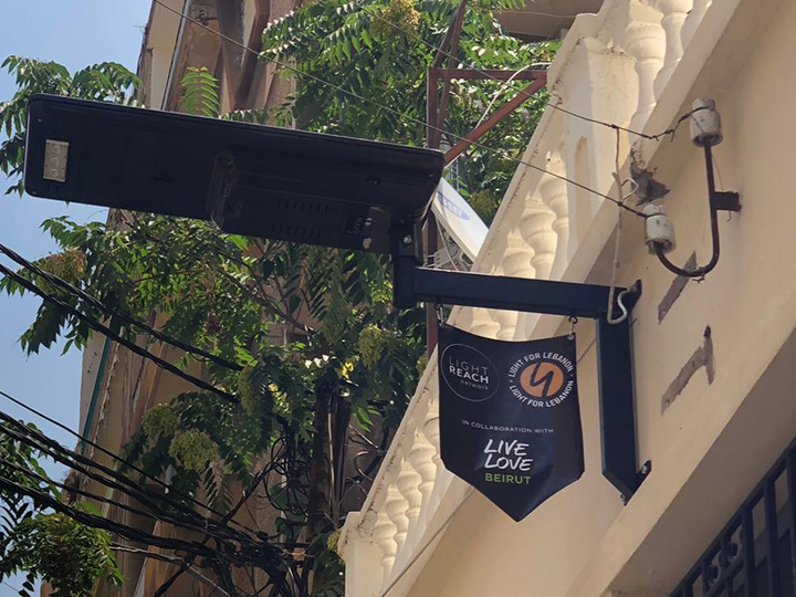 Streetlight with banner showing our logos